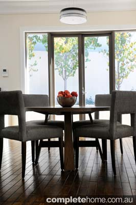 Round tables in dining rooms are functional and allow easy movement