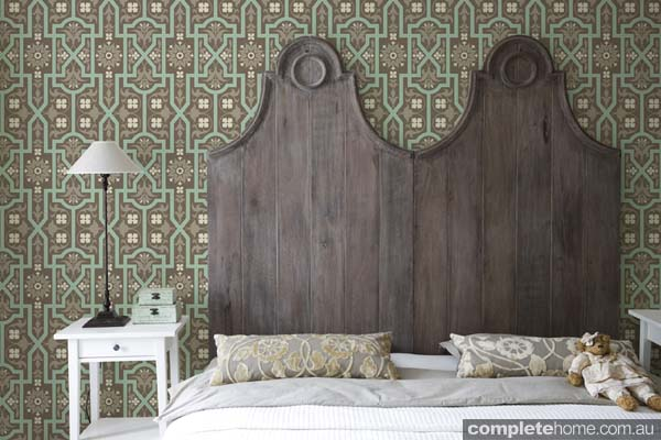 Rustic bedroom with green wallpaper