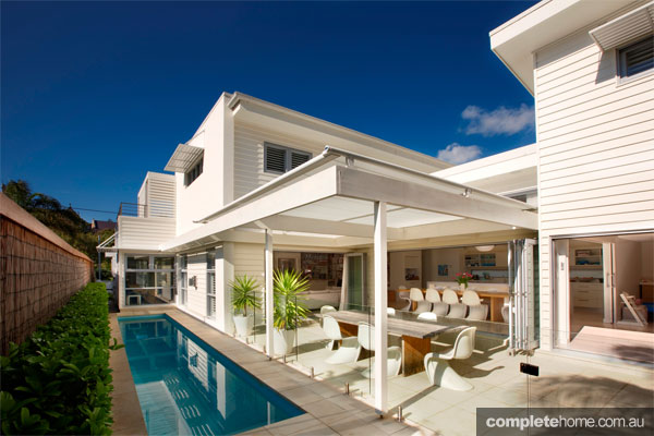 Quintessential beach house completehome for Beach style kit homes
