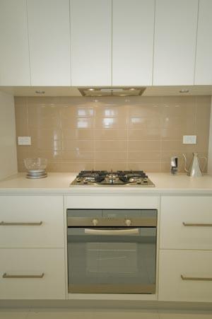 A clean classic Carrera Kitchens design featuring the Laminex Stringybark horizontal grain panel