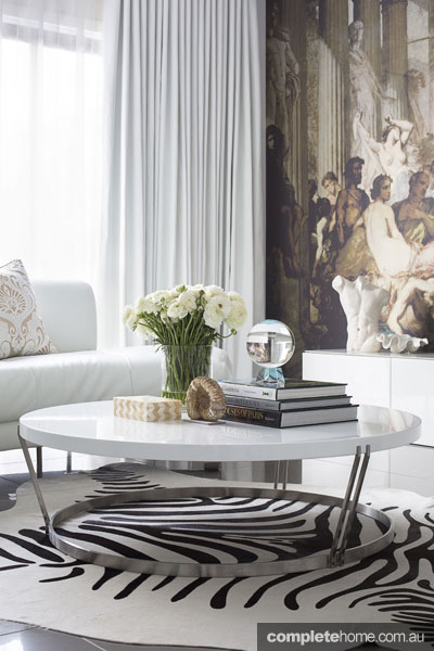 Italian elegance: Zebra rug, living room by Massimo Interiors