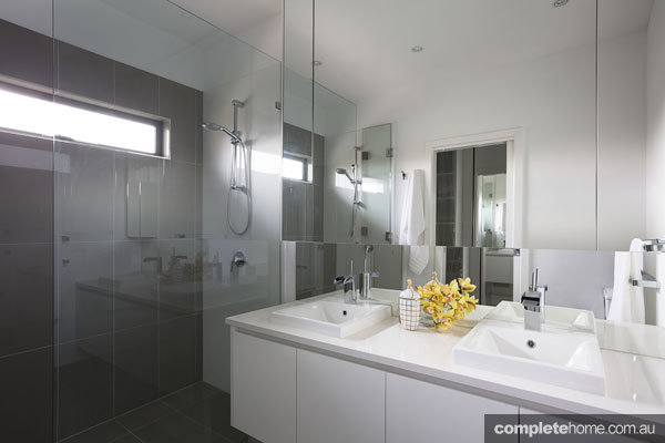 Italian elegance: Grey ensuite bathroom by Massimo Interiors