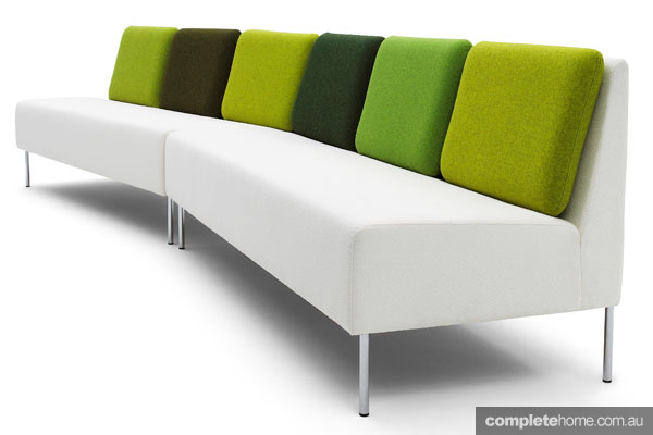 Statement sofas: White sofa with green pillows
